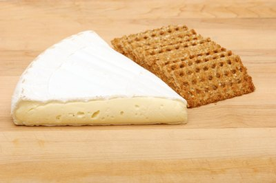 Add some low-fat cheese to whole wheat crackers for a balanced afternoon snack.