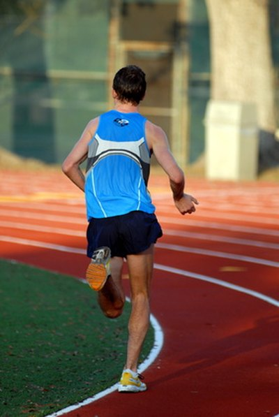 Track and field has a long history. Photo Credit man running in blue ...