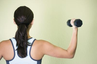 Back view of a woman doing a bicep curl.