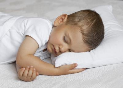 Toddler resting on bed