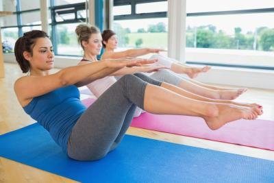 For a total core-based workout, take a few Pilates classes to target your abs in a new way.