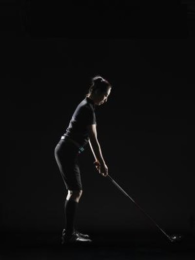 What Is the Difference Between Bending at Your Waist & Bending at Your Hips in a Golf Swing?