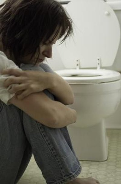 What Are the Causes of Vomiting & Severe Stomach Cramps?