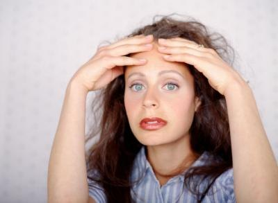 Back Pain, Cramping, Spotting & Headaches 2 Days Before a Period
