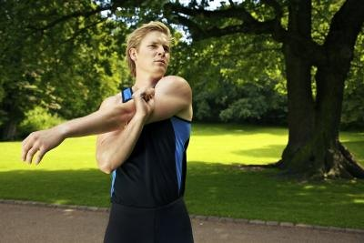 man doing an arm exercise outdoors