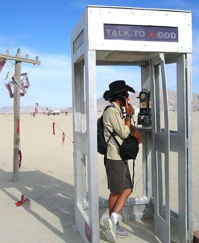 "My husband Chris talked to ""God"" in a phone booth in the middle of the desert at Burning Man 2006. I seem to recall that God was a woman."