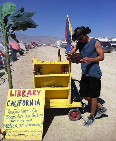 "Checking out books at the ""Library California"" – ""You can check out books any time you like, but they can NEVER be returned"" at Burning Man 2012."