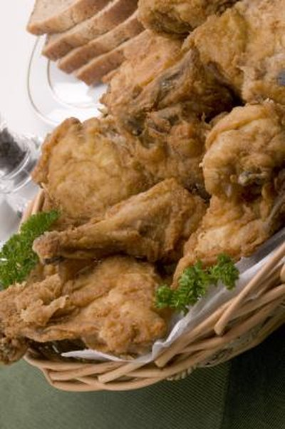 can you boil chicken first before frying? | livestrong