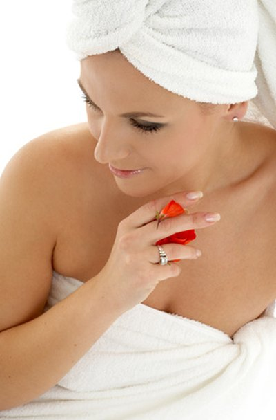 Cover the hair with a towel after applying the oils.