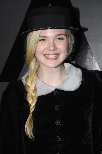 Actress Elle Fanning in a menswear-style bowler with a glitter brim