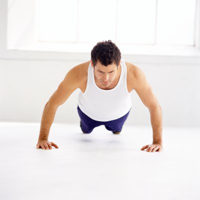 Burpees are a squat thrust with a pushup at the bottom of the movement and a vertical jump at the top.