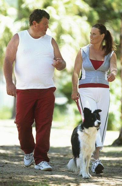 Walking a dog can combine exercise with an enjoyable chore.