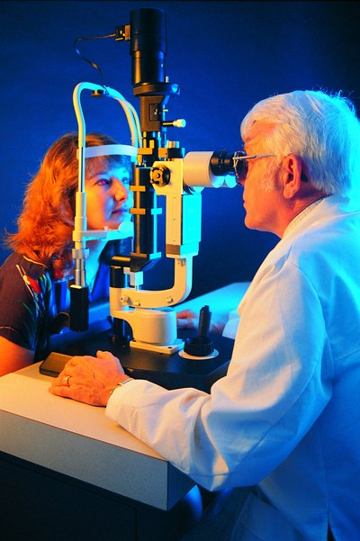 Doctor examing a woman's eyes