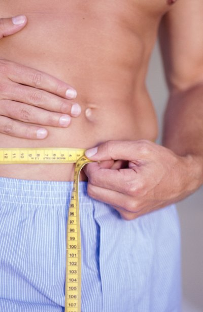 Reduce body fat to reveal defined stomach muscles.