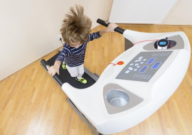 boy running on a treadmill in an apartment photo credit oneblink cj