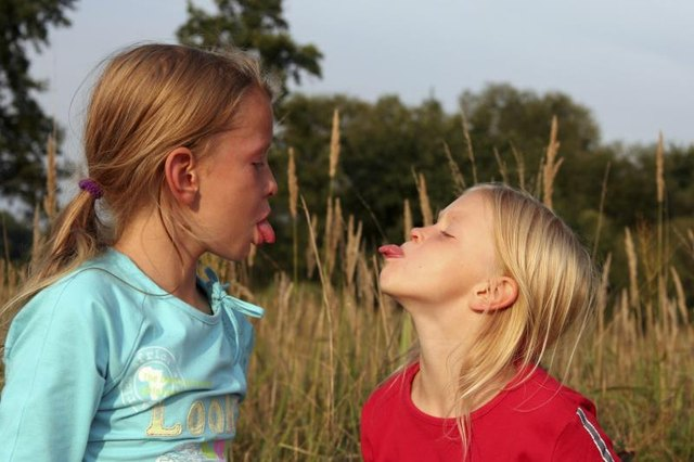 The Rude Child's Behavior of Sticking out the Tongue