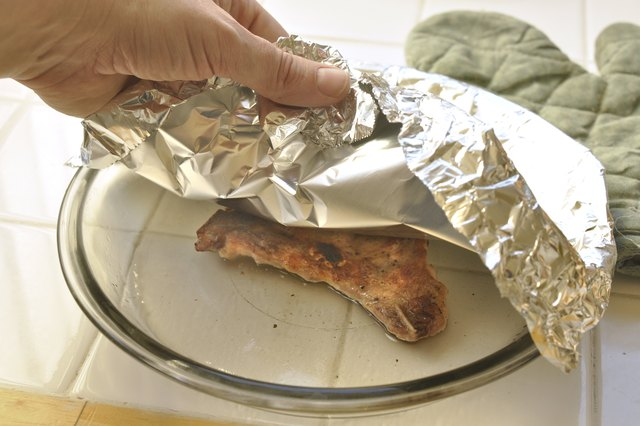 How to Heat Up Leftover Pork Chops & Make Them Tender