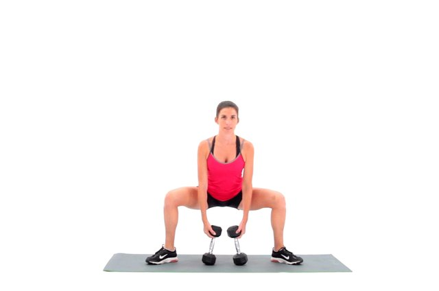 Proper form for a dumbbell sumo squat.