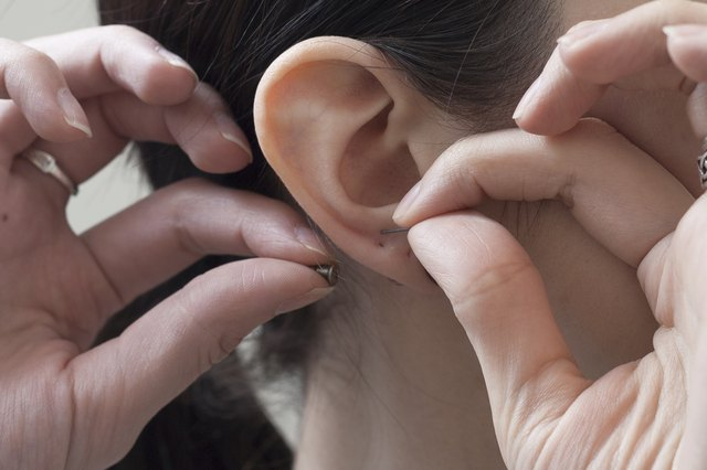 How to Remove Pierced Earrings From Your Ear