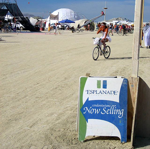 Sign advertising condos for sale on the esplanade at Burning Man 2006.
