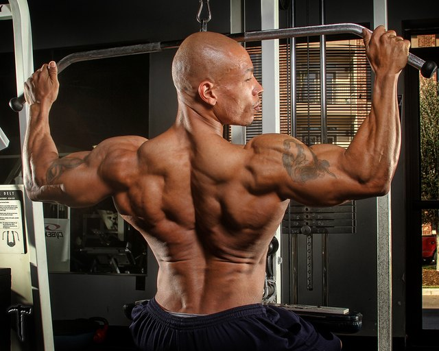 Lat pulldowns strengthen all the muscles of your upper back.