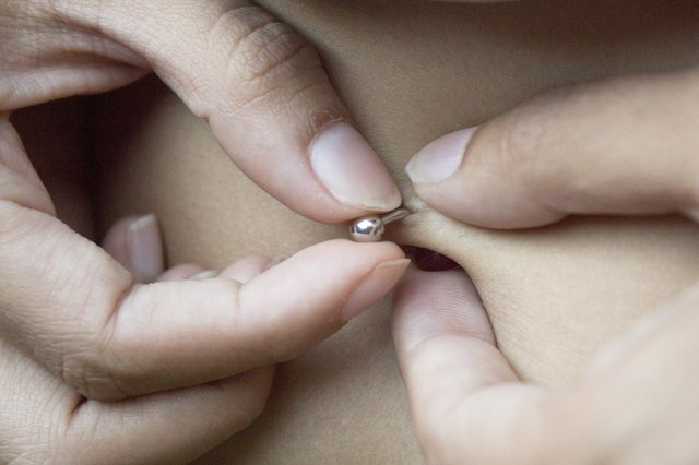 How to Take Out a Silver Hoop Belly Button Ring