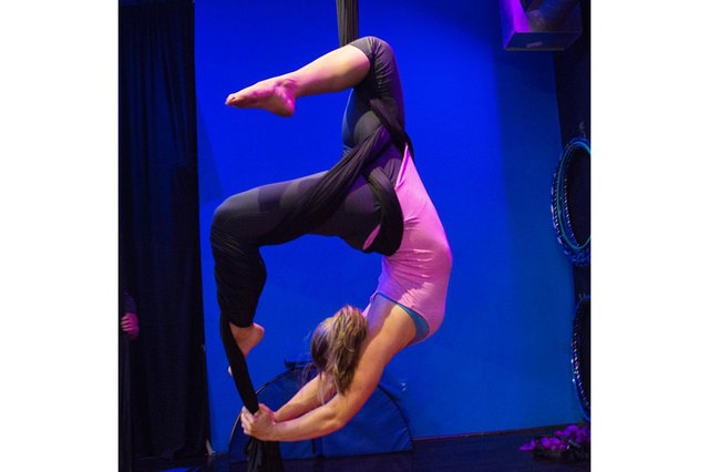 Author Jamie Lebowitz demonstrates a pose on aerial silks.
