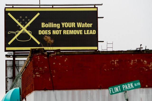 A billboard PSA for Flint residents: Boiling water doesn't remove lead.