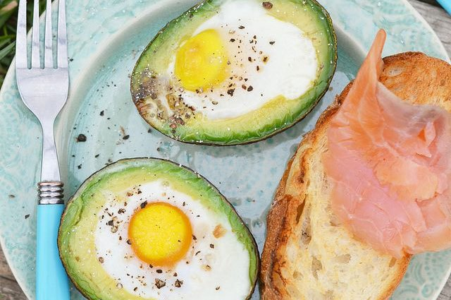 Here's an idea: Put eggs in the middle of the avocado where the seed was.