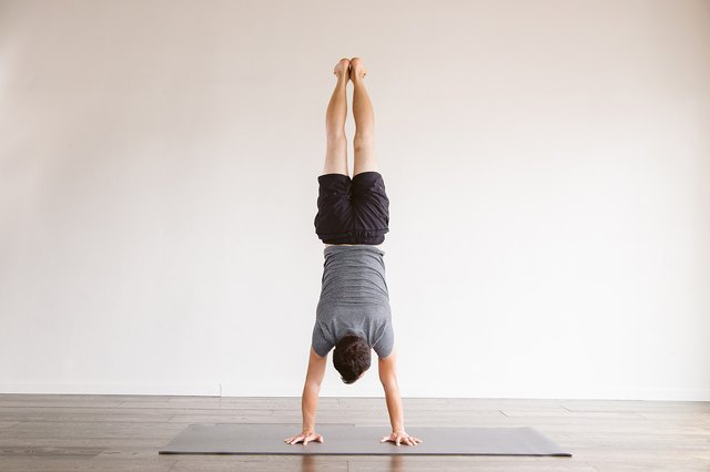Tamal Dodge in Handstand pose.