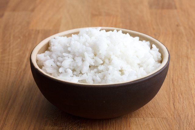 Cook rice along with coconut oil, then cool it to significantly boost resistant starch (perhaps tenfold) and potentially cut in half the calories!
