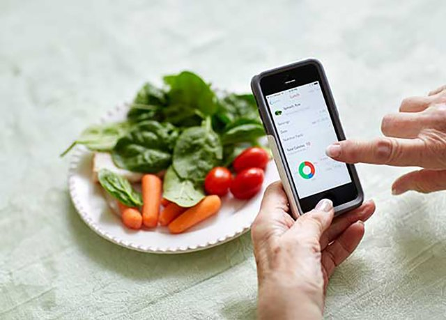 The LIVESTRONG.COM MyPlate app helps Dianna J. keep track of her meals.