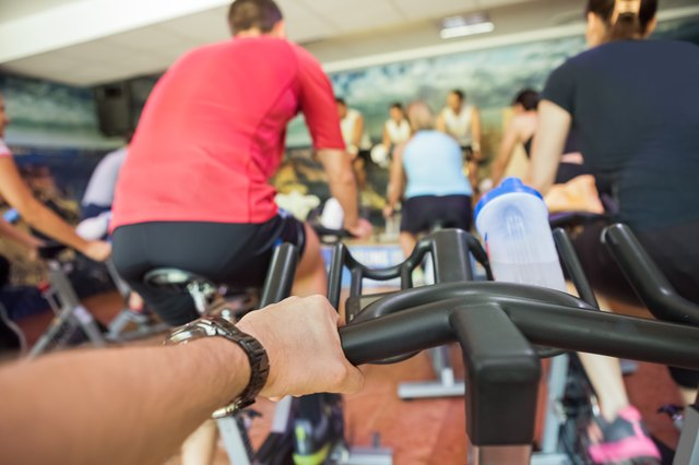 Pounding music and inspiring instructors can make an indoor cycling class fly by.