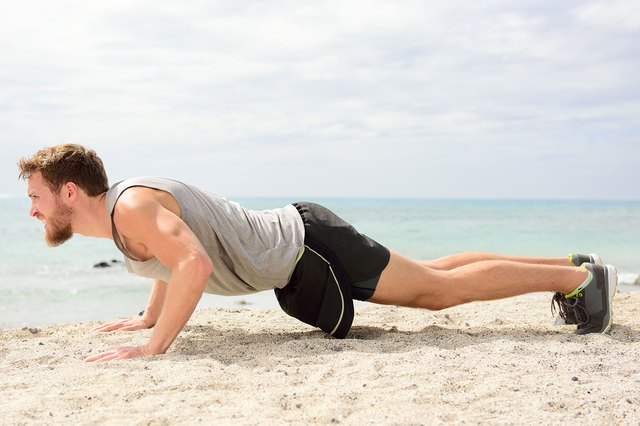 Sand burpees will get your heart racing and help build full-body strength.