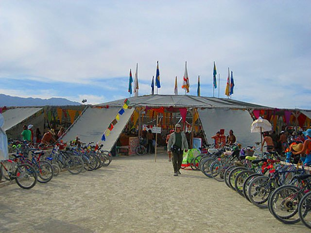 Bikes lined up at the racks outside the Center Camp Cafe at Burning Man 2006.