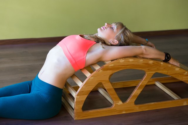 Get help opening your chest during backbends with this strange-looking prop.