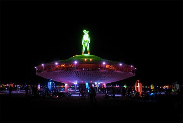 The Man at Burning Man 2013 stood atop a giant flying saucer.