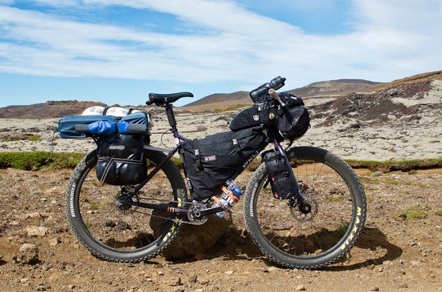 The author used rear racks and small panniers to carry four to five days worth of food for Iceland's remote regions and typical framebags, a lightweight and efficient solution for off-road riding.