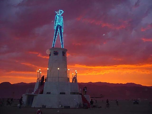 The Man during a sunset at Burning Man 2002.