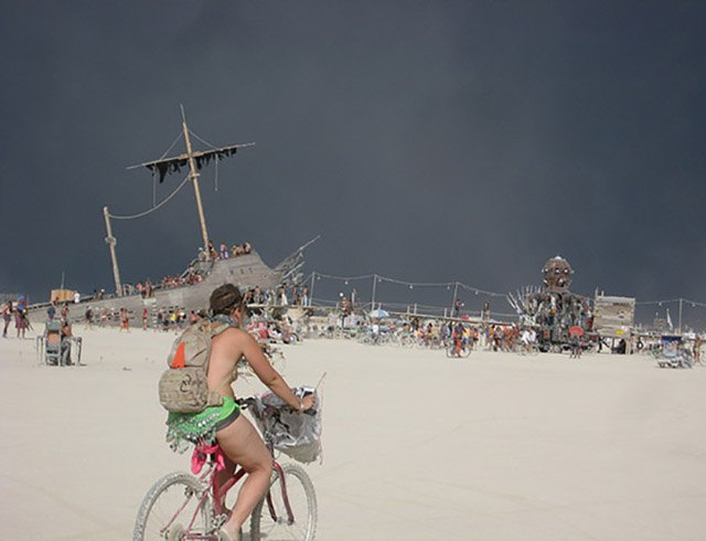 A dust storm darkens the sky at Burning Man 2012.