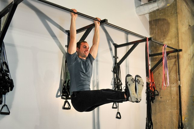 Work your abs with a hanging leg raise.