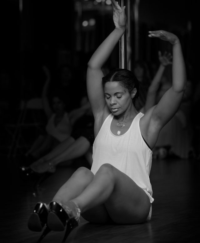 Gina DeRoos performs at a showcase for Venus Pole Fitness, where she instructs classes.