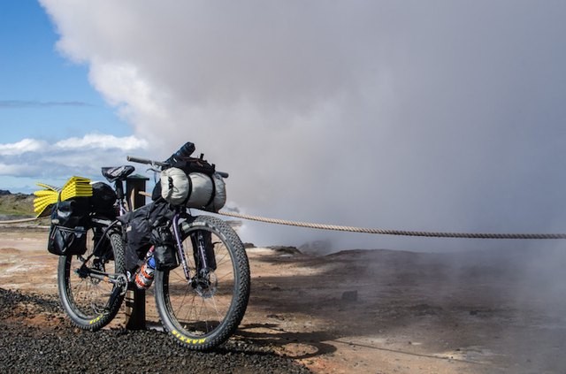 A bikepacking setup like this one keeps your gear packed tightly to the frame, minimizing movement on rough roads.