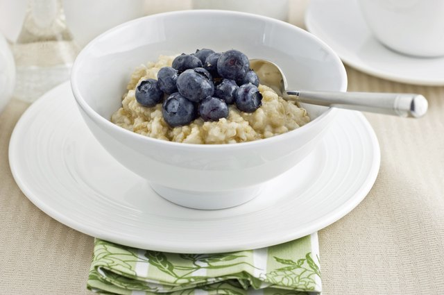 A bowl of oatmeal topped with fresh blueberries.