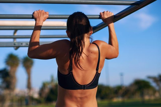 Do a pull-up wherever you find a stable bar.