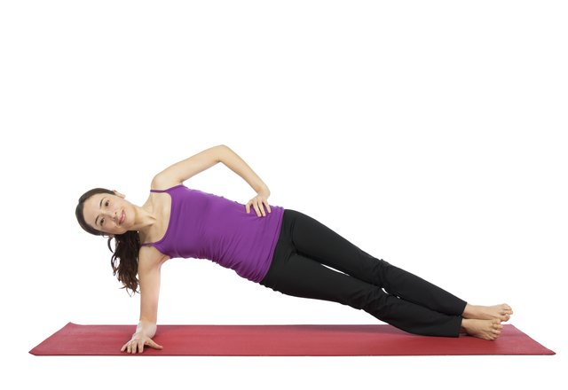 Start in a side plank position before moving into the Side Bridge.