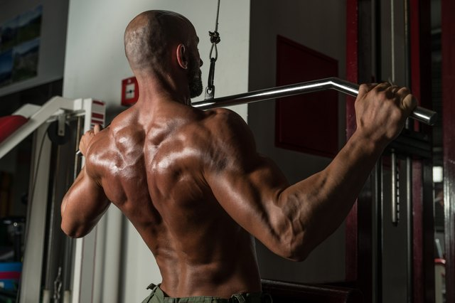 Pull the lat bar down to your collar bones.