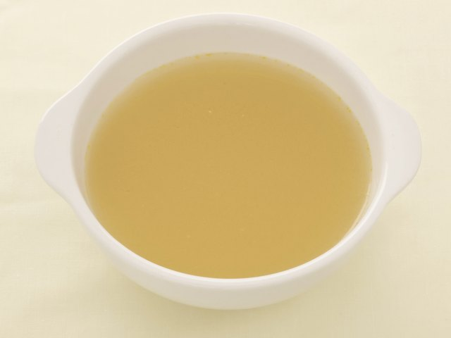 Chicken broth in bowl.