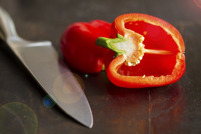 Knife with half a red pepper