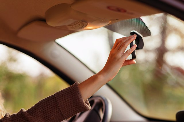 Shoulder flexion makes reaching for the rear view mirror possible.